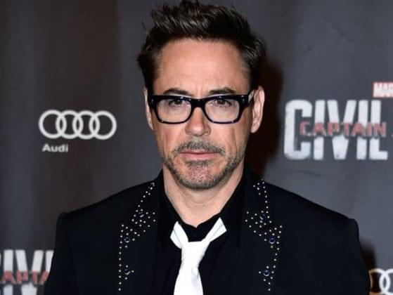 At what age does Robert Downey Jr claim he got addicted to drugs?