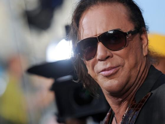 Mickey Rourke was arrested in 1994 for what?