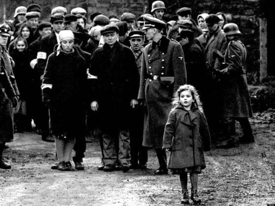What is the color of the girl's coat in this iconic picture from the