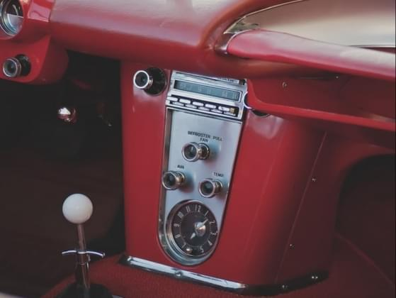 If the radio is on in the car, which station is it tuned to?