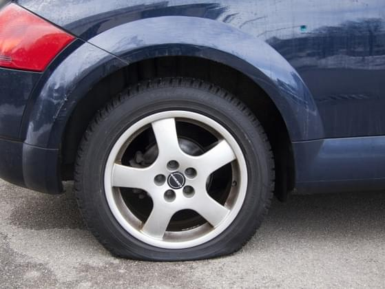 What do you do if you pop a tire while driving?