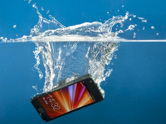What should you do when you drop your cell phone in water?