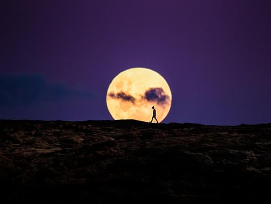 When the visible (lit) portion of the moon is increasing (getting brighter), the moon is:
