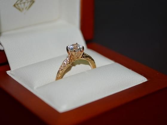 Do you want your engagement ring to have a diamond in it/would you buy an engagement ring with a diamond in it?