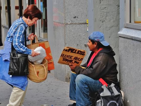 If you're on a busy city street and see a homeless person begging for coins on the sidewalk, what do you do?