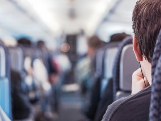 If you notice that someone is nervous in the airplane seat next to you, what do you do?