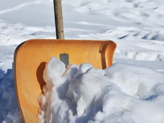 After a snowstorm, you notice your neighbor struggling to shovel her driveway. What do you do?
