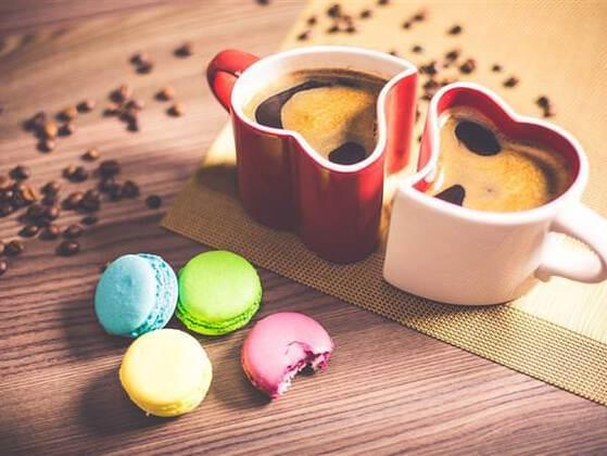 A couple sits down to have a cup of coffee and some chocolate cookies. One of them eats a lot of cookies at once, while the other takes a bite out of each one to see what is in them. Who is the second person?