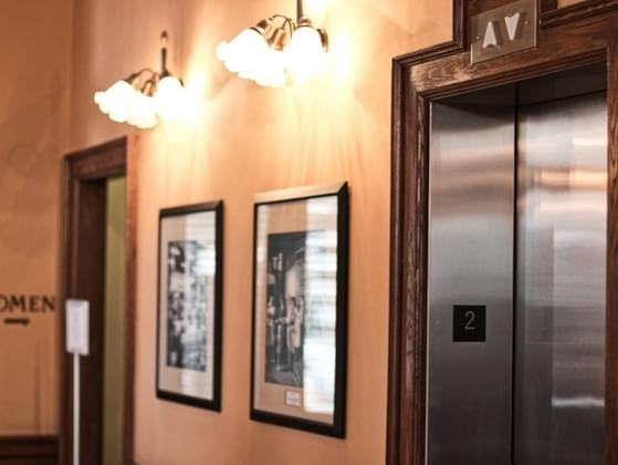 You're stuck in an elevator with an older lady. Do you make small talk?