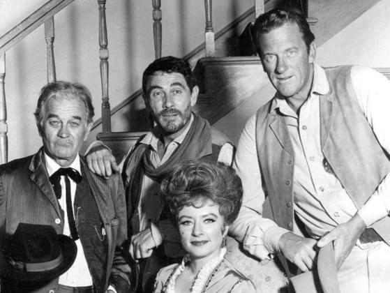The main three characters in 'Gunsmoke' (1955-1975) are Marshall Matt Dillon, Miss Kitty Russell, and _____ Adams.