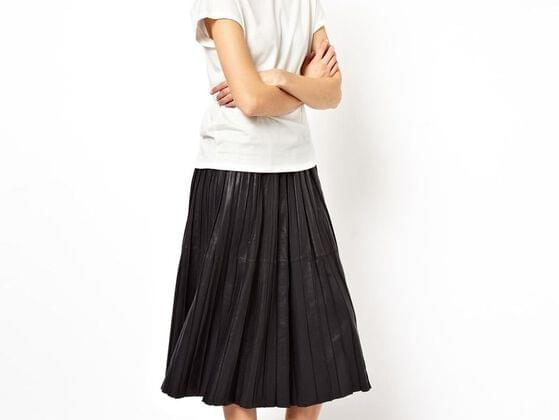 A pleated leather midi skirt is a perfect go-to-dress for parties. Do you have it?