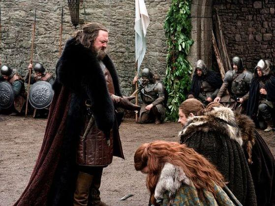 How long did it take Robert and the royal entourage to ride to Winterfell from King's Landing?