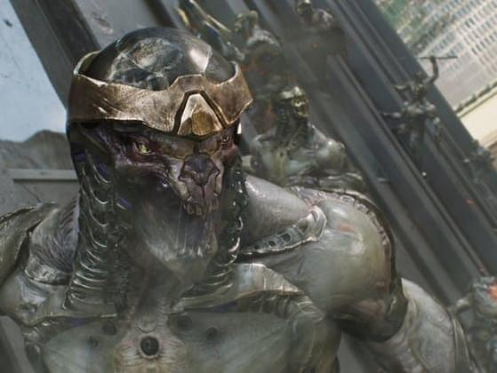Who diverts a nuclear missile into a wormhole and defeats the Chitauri army?