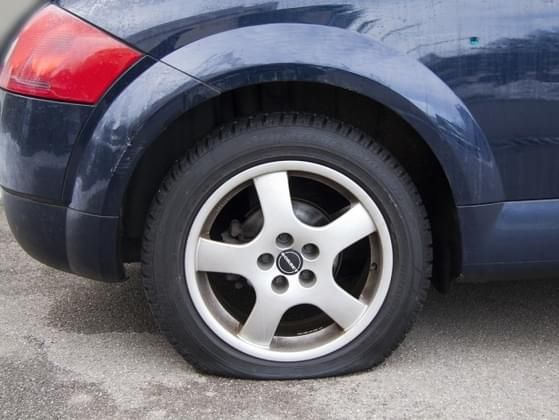 You have a flat tire on the side of the road. What do you do?