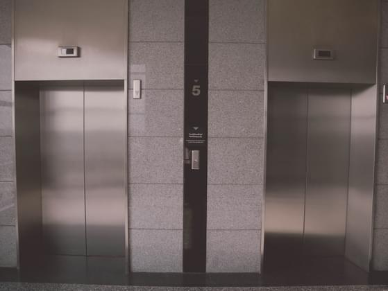 You're in the elevator when you see a mom with a stroller asking you to hold the door. What do you do?
