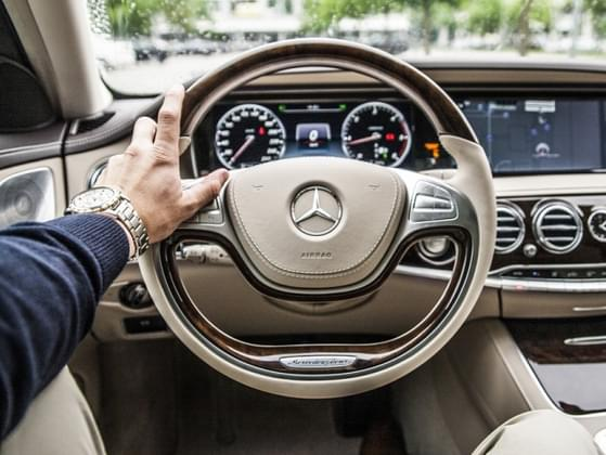 If you are borrowing a friend's car and you first climb in and look out the windshield, you can see the top ____% of the steering wheel.