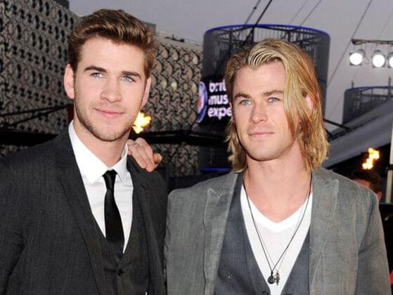 Who is Liam Hemsworth's famous sibling?