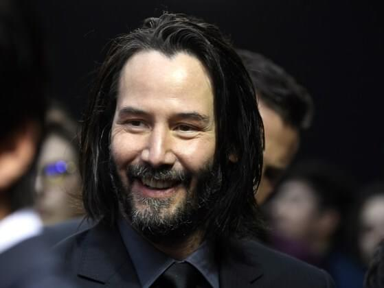 What is Keanu Reeves' biological father's profession?