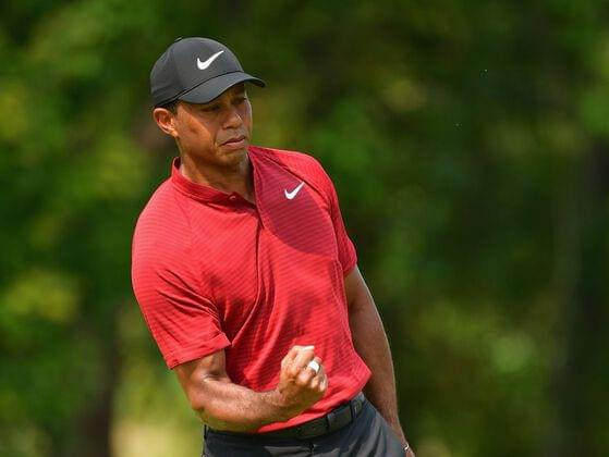 In 2000, a year that brought him three titles, which title did Tiger Woods not win?