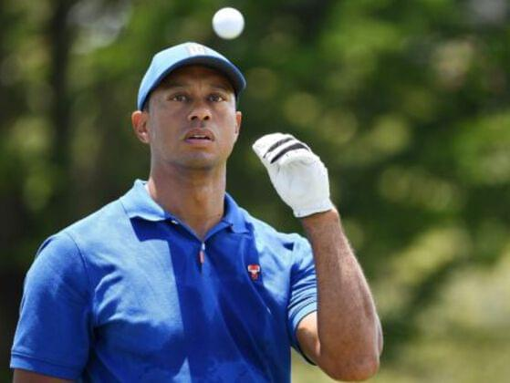 How many professional major championships had Tiger Woods won by the age of 25?
