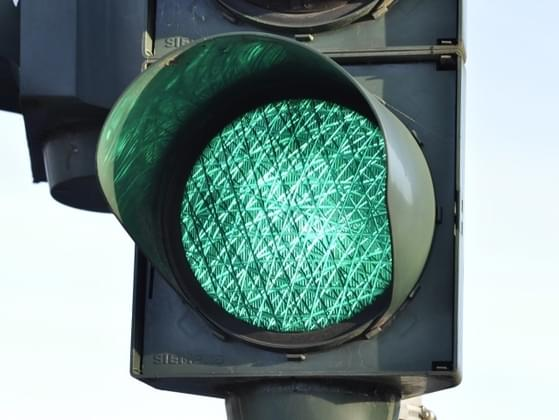 The traffic light turns yellow as you approach. What do you do?