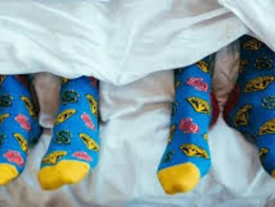 Is It Totally Weird To Wear Socks To Bed?