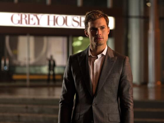 What is the full name of Christian Grey's company?
