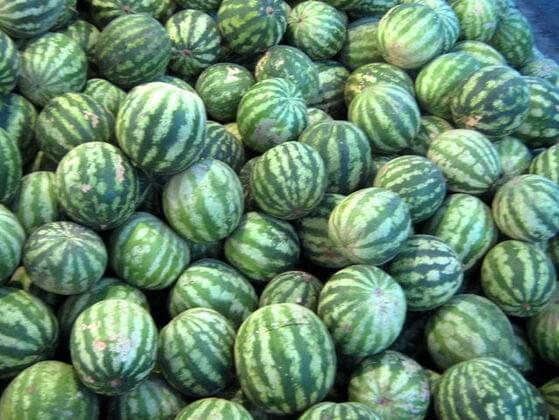 Farmers at a Farmer's Market are trading their produce. One farmer trades another farmer 13 turnips for 5 watermelons. How many turnips can a farmer with 25 watermelons get?