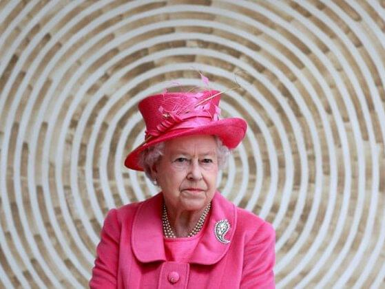 Other than English, what language is the Queen perfectly fluent in?